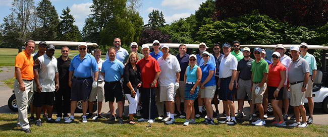 Golfers pose for photo at the Brentwood Country Club