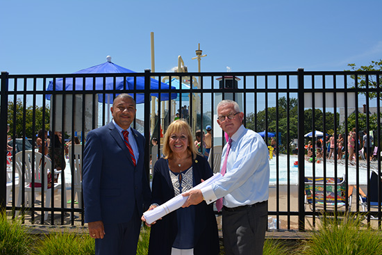 Assemblyman Phil Ramos; Supervisor Angie Carpenter; Parks and Recreation Commissioner Tom Owens stand in front of spray park