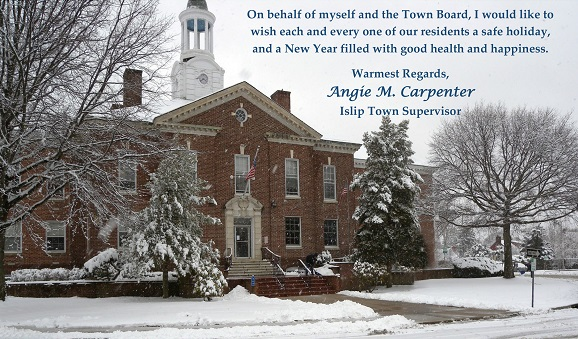 2019 Celebration image of Town Hall in the snow, with warm wishes for the new year from Supervisor Carpenter and the Islip Town Board